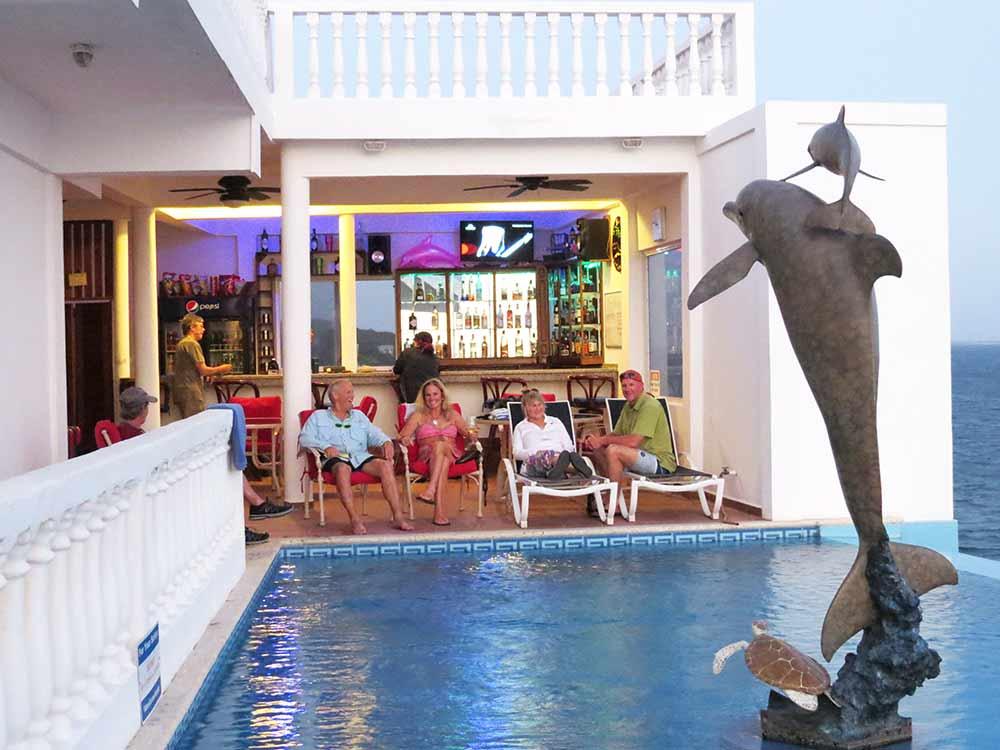 guests at pool bar