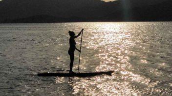 standup paddleboarding at sunset